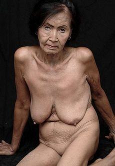 Elder woman shows her naked old..