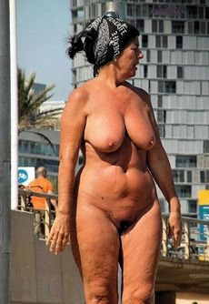 Naked old woman on vacation,..