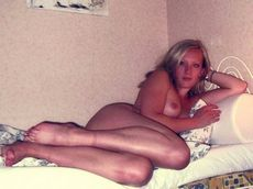 Pure mature blonde laying nude..